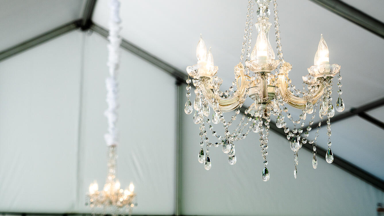 Chandeliers hanging in a tent.