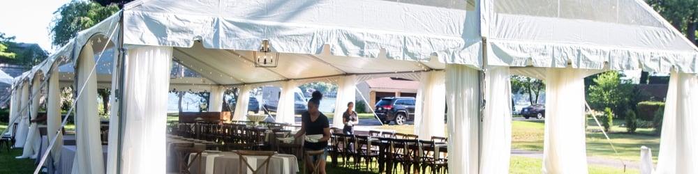 An Alpine team member sets up a tent